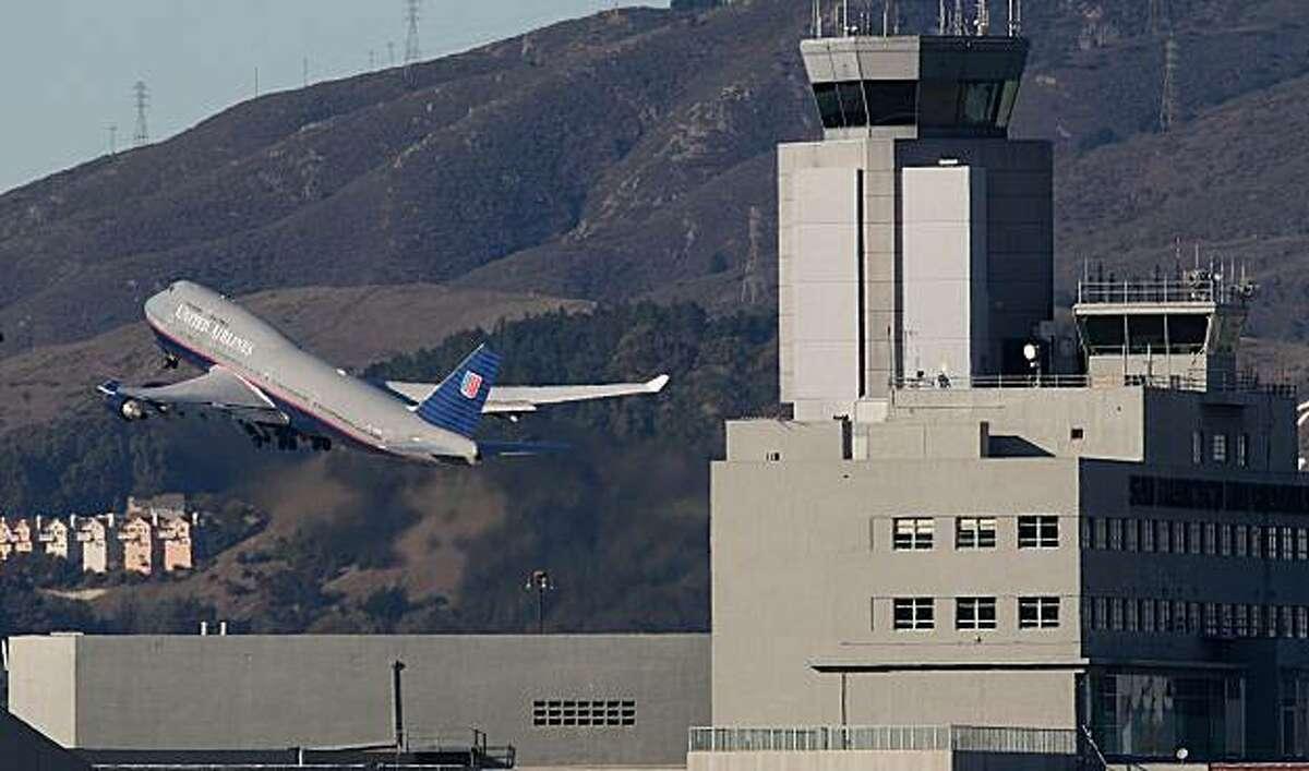 Planes taking off and landing at San Francisco International Airport.
