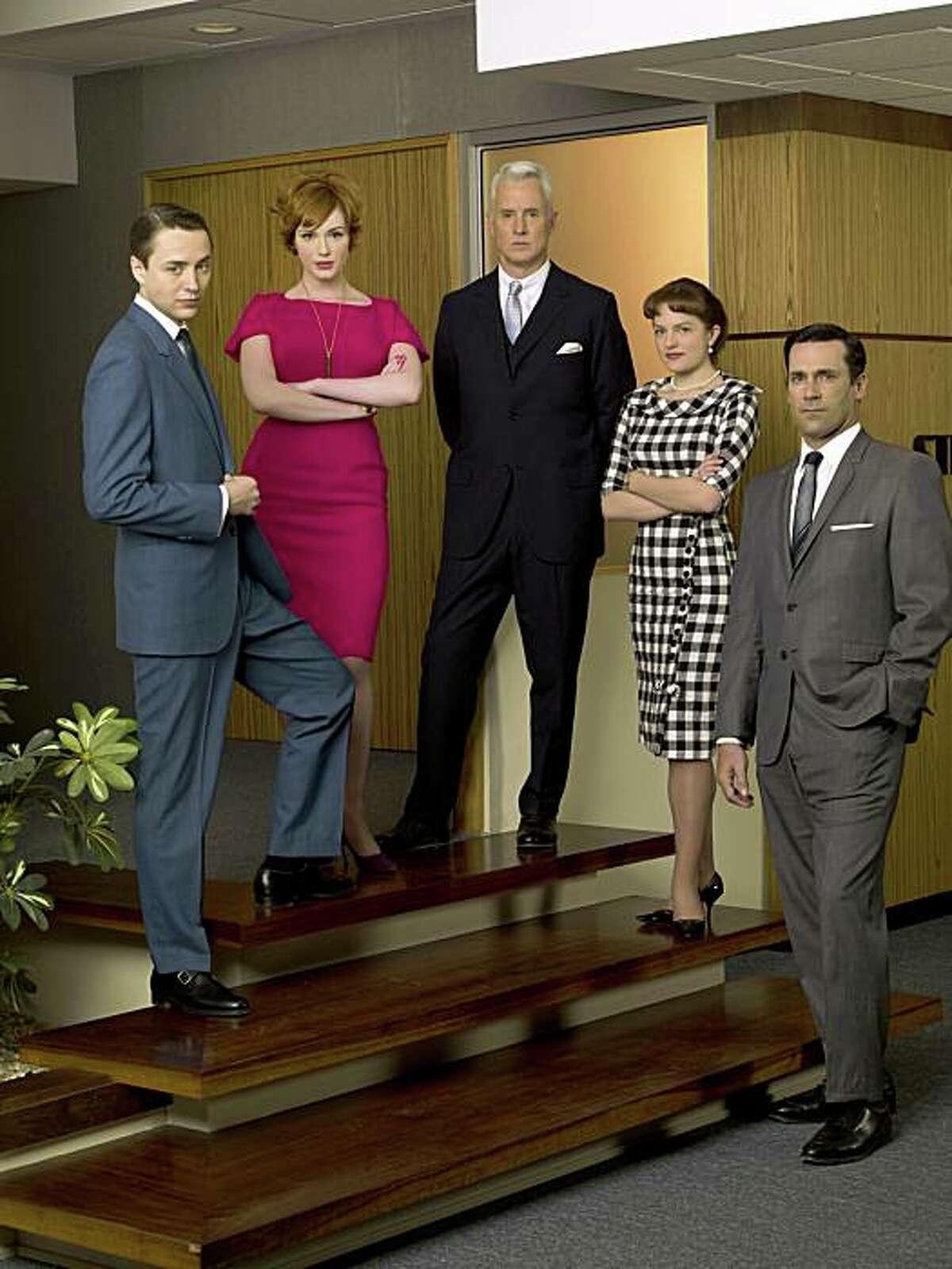 AMC Mad Men cast shot at the Sterling Cooper office: Pete Campbell (Vincent Kartheiser), Joan Holloway (Christina Hendricks), Roger Sterling (John Slattery), Peggy Olson (Elisabeth Moss), Don Draper (Jon Hamm).