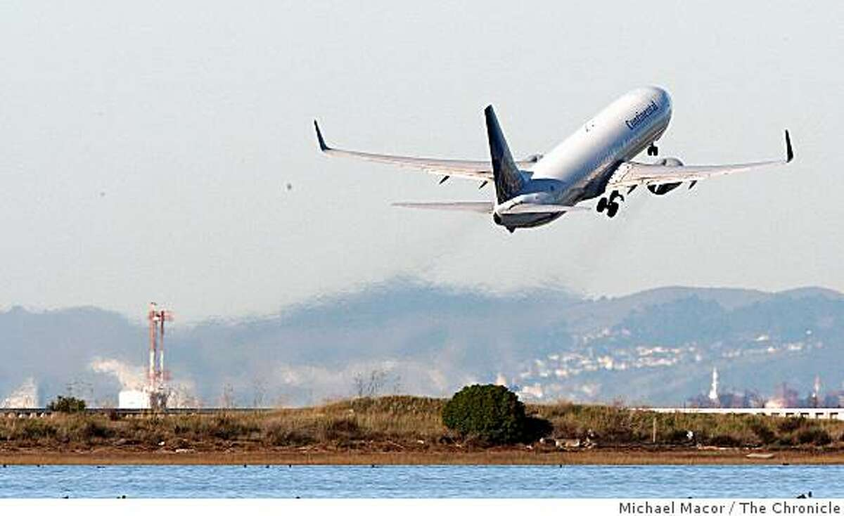 Planes taking off and landing at San Francisco International Airport on Wednesday Dec. 17, 2008