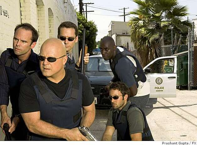 THE SHIELD: L-R: Walton Goggins, Michael Chiklis, David Rees Snell, Michael Jayce and Alex Laughlin (kneeling). Photo: Prashant Gupta, FX