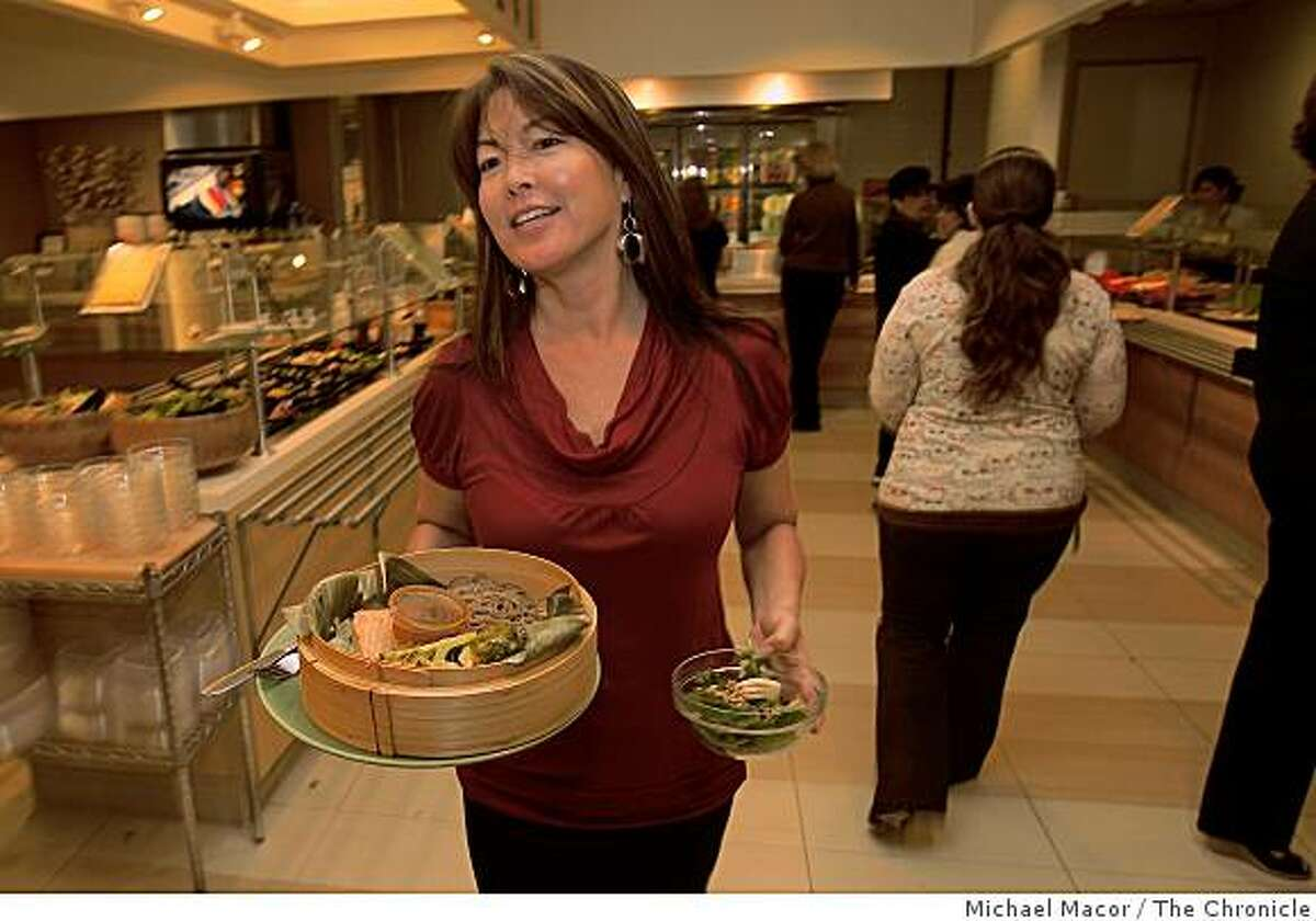 Cathy Ikeuchi takes advantage of the company caferteria, at the headquarters of Safeway Food Stores in Pleasanton, Calif. where food items are listed with nutritional information so employees can make selections for their individual needs, lunch time on Friday Dec. 5, 2008.