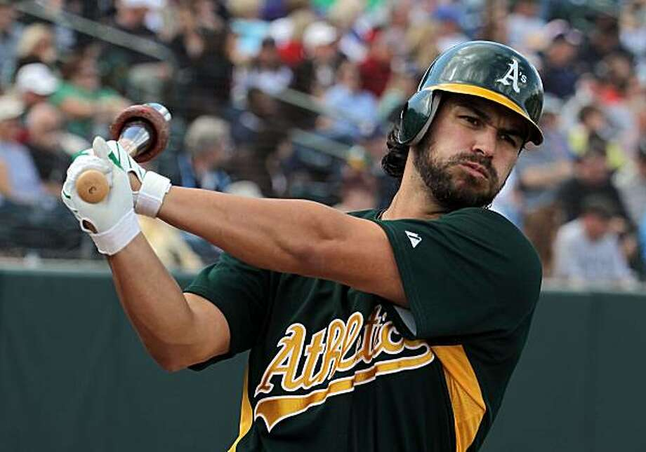 PHOENIX - MARCH 10:  Eric Chavez #3 of the Oakland Athletics warms up on deck during the MLB spring training game against the Chicago White Sox at Phoenix Municipal Stadium on March 10, 2010 in Phoenix, Arizona. Photo: Christian Petersen, Getty Images