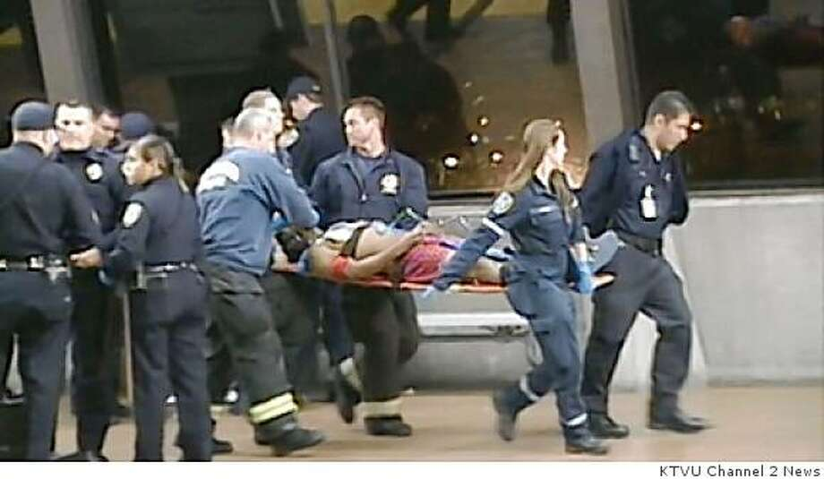 22-year-old Oscar Grant is carried out of the Fruitvale BART station on January 1, 2009. According to BART spokesman Jim Allison the victim was shot on the platform when a BART police officer's firearm discharged. Photo: KTVU Channel 2 News