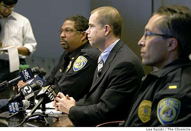 Bart Spokesperson James Allison (center) speaks to the media during a press conference in Oakland, Calif. on Thursday January 1 ,2009  regarding the shooting of 22-year old Oscar Grant by a BART police officer early on New Year's Day at the Fruitvale station. Travis Gibson (left), Patrol Bureau Commander with the BART Police and Lt. Frank Lucarelli (right) of the BART Police also attended the press conference. Photo: Lea Suzuki, The Chronicle