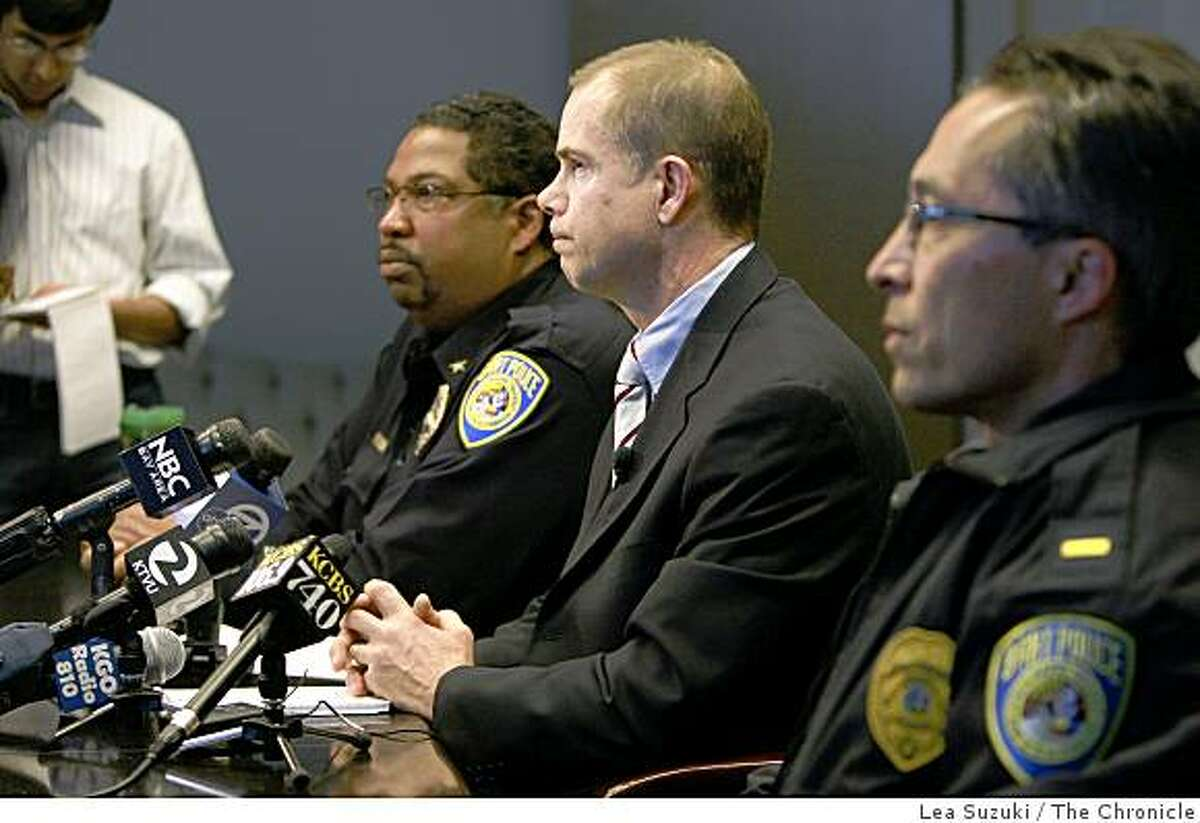 Bart Spokesperson James Allison (center) speaks to the media during a press conference in Oakland, Calif. on Thursday January 1 ,2009 regarding the shooting of 22-year old Oscar Grant by a BART police officer early on New Year's Day at the Fruitvale station. Travis Gibson (left), Patrol Bureau Commander with the BART Police and Lt. Frank Lucarelli (right) of the BART Police also attended the press conference.