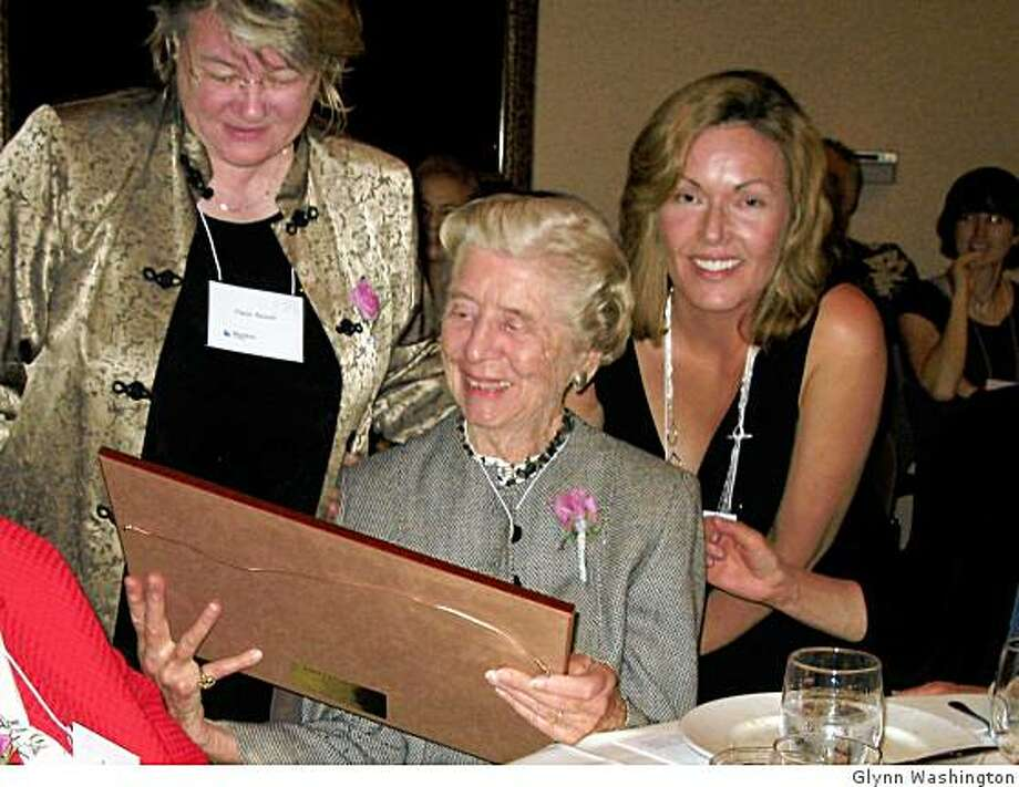 """Alba Witken (seated, center), president of the Bernard E. and Alba Witkin Charitable Foundation, receives a framed photo and certificate of appreciation for her support from the BlueSkies for Children 25th Anniversary Gala, on October 2, 2008, at Nile Hall in Preservation Park in Oakland. BlueSkies is a child-care center in Oakland. Pictured with her are Claire Bainer (left), co-director of BlueSkies for Children, and Audrey Young (right), chair of the capital campaign for BlueSkies. A quote on the certificate is from John Dewey, the great American educator:""""What the best and wisest parent wants for his own child ? that must be what the community wants for all its children."""" Photo: Glynn Washington"""