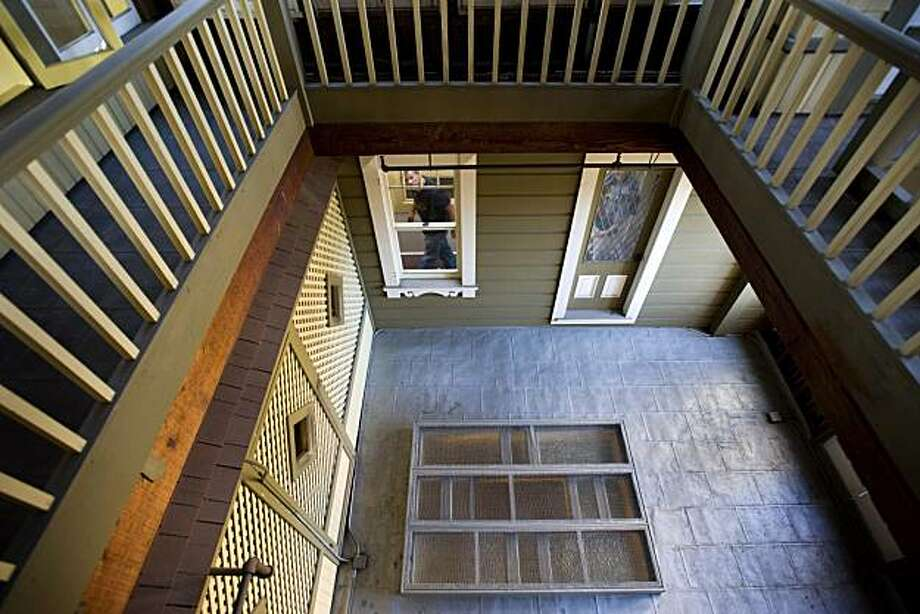 A tourist peaks through a window on the second floor of the Winchester Mystery House in San Jose, Calif., on Tuesday, June 29, 2010.  This area of the house was once the roof but has been enclosed not once, but twice, as Sarah Winchester added roof upon roof over the years. Photo: Chad Ziemendorf, The Chronicle