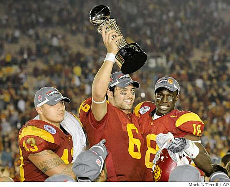 Southern California quarterback Mark Sanchez (6) holds up the trophy as he celebrates with teammates Kaluka Maiava, left, and Damian Williams (18) after USC beat Penn State 38-24 in the Rose Bowl NCAA college football game in Pasadena, Calif., Thursday, Jan. 1, 2009. (AP Photo/Mark J. Terrill) Photo: Mark J. Terrill, AP