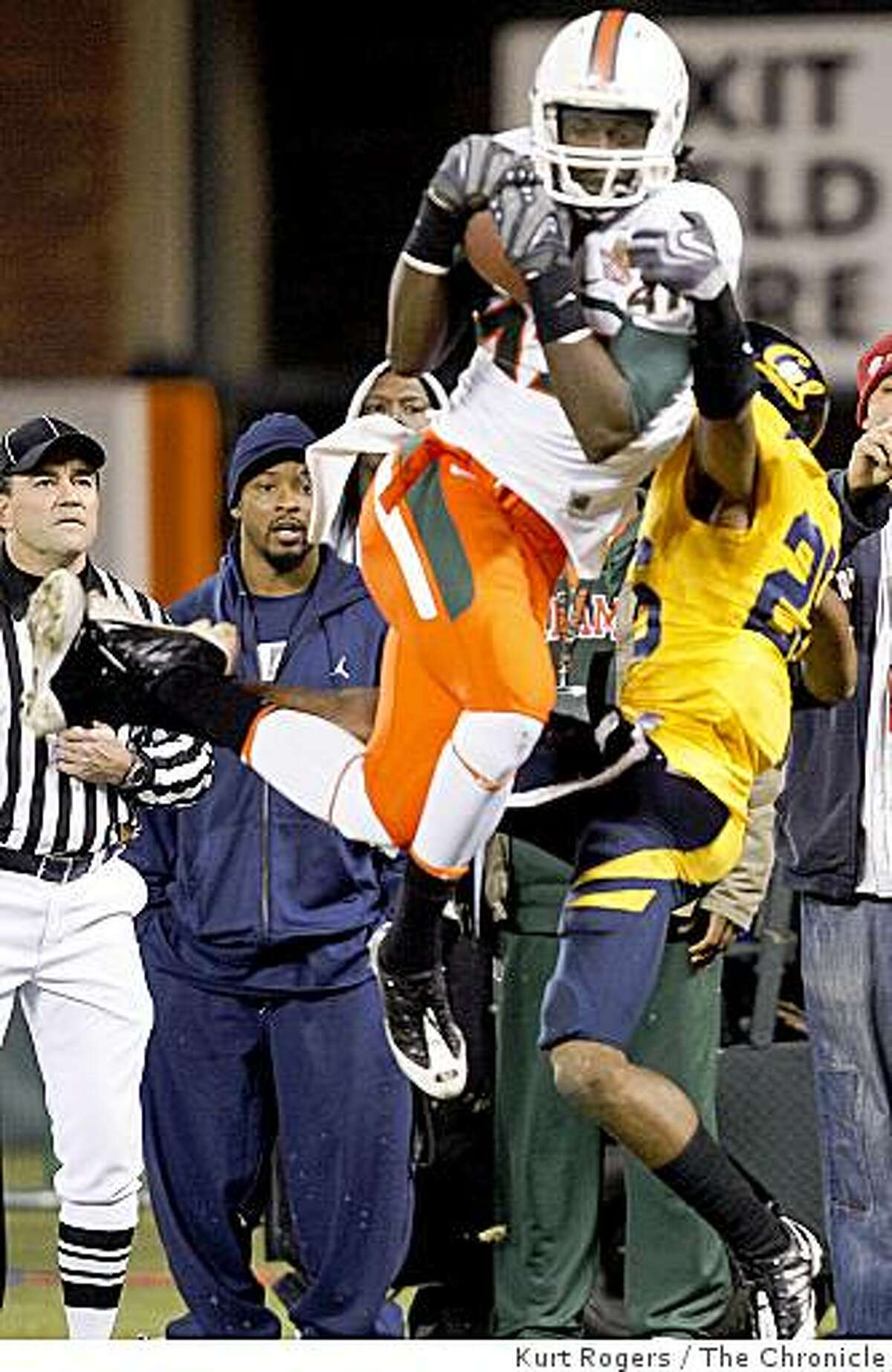 Miami's Laron Byrd hauls in a pass for a touchdown over Cal's Covaughn DeBoskie in the second quarter of the Emerald Bowl on Saturday, Dec 27, 2008 in San Francisco, Calif.