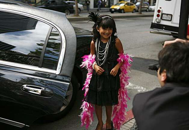 7-year old Kassaundra Ramirez of San Jose, who was born with cardiomyopathy, a life-threatening heart condition, stops to have her photo taken before entering into a limousine which will drive her to her mock press conference in the Grand Hyatt Hotel in San Francisco, Calif. on Friday August 13, 2010. The Make a Wish Foundation is granting Kassaundra's wish to be a famous singer and has provided her with a Gymboree shopping spree for her wardrobe, voice lessons, professional head shots, a recording session at 107.7, a new music video, and hair and make up styling. Photo: Jasna Hodzic, The Chronicle