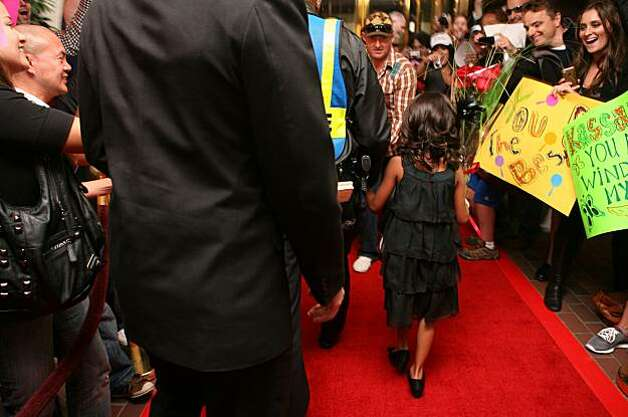 7-year old Kassaundra Ramirez of San Jose, who was born with cardiomyopathy, a life-threatening heart condition, walks on the red carpet laid out for her in front of the Grand Hyatt Hotel, where a mock press conference was held for Kassaundra, in San Francisco, Calif. on Friday August 13, 2010. The Make a Wish Foundation is granting Kassaundra's wish to be a famous singer and has provided her with a Gymboree shopping spree for her wardrobe, voice lessons, professional head shots, a recording session at 107.7, a new music video, and hair and make up styling. Photo: Jasna Hodzic, The Chronicle