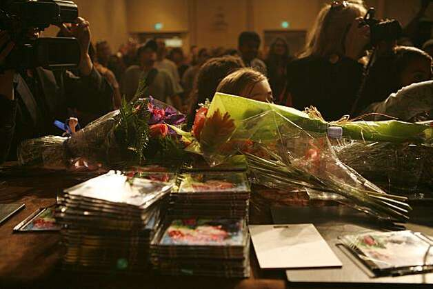 CDs and flowers adorn the table in front of 7-year old Kassaundra Ramirez , who was born with cardiomyopathy- a life-threatening heart condition- at a mock press conference set up for her by the Make a Wish Foundation at the Grand Hyatt Hotel in San Francisco, Calif. on Friday August 13, 2010. The Make a Wish Foundation is granting Kassaundra's wish to be a famous singer and has provided her with a Gymboree shopping spree for her wardrobe, voice lessons, professional head shots, a recording session at 107.7, a new music video, and hair and make up styling. Photo: Jasna Hodzic, The Chronicle