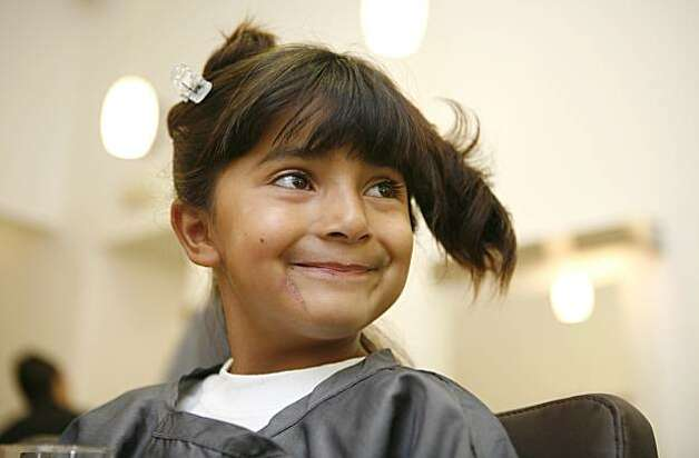 7-year old Kassaundra Ramirez of San Jose, who was born with cardiomyopathy, a life-threatening heart condition, gets her hair and make-up done in preparation for her debut as a famous singer at the Diva International hair salon in San Francisco, Calif. on Friday August 13, 2010. The Make a Wish Foundation is granting her wish to be a famous singer. Photo: Jasna Hodzic, The Chronicle