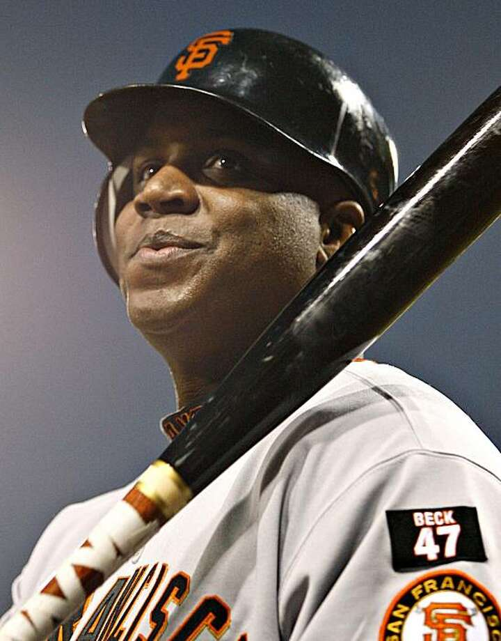 In this Sept. 15, 2007, file photo, San Francisco Giants' Barry Bonds waits before his at-bat in the second inning of a baseball game against the San Diego Padres in San Diego. The baseball players' union says it has found evidence teams acted in concert against signing Bonds but it reached an agreement with the commissioner's office to delay the filing of any grievance. (AP Photo/Denis Poroy,file) Photo: Denis Poroy, AP