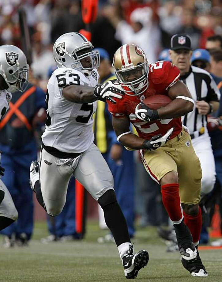 San Francisco 49er Glen Coffee (29) with a big run in the first quarter, chased by Oakland Raider Thomas Howard (53) as the San Francisco 49ers take on the Oakland Raiders at Candlestick Park in San Francisco, Calif., on Saturday August 22, 2009, in a pre-season game. Photo: Michael Macor, The Chronicle