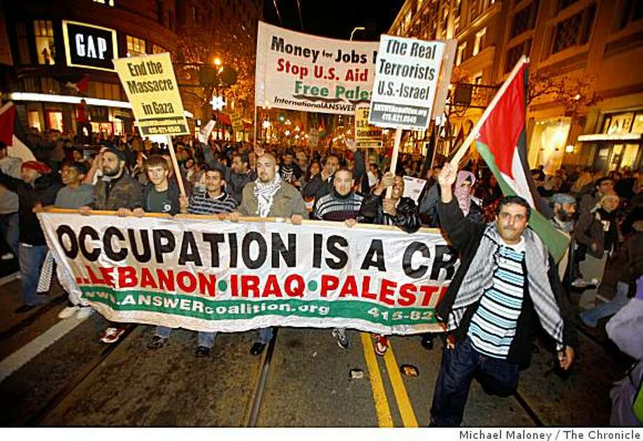 Bay Area activists hit the streets of San Francisco Tuesday, December 30, 2008 to protest the continuing Israeli offensive against Hamas, seen here marching down Market Street. Photo: Michael Maloney, The Chronicle