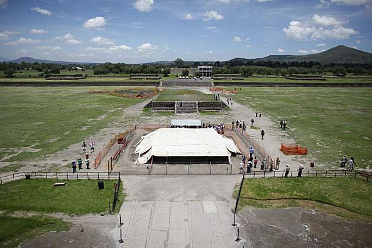 A tent marks the site where Mexican archaeologists are working on what they describe as a mysterious, 100-meter tunnel found in Teotihuacan, Mexico, Tuesday, Aug. 3, 2010. Archeologists say the tunnel was probably closed intentionally about 200 A.D. and it may well hold chambers with tombs of the rulers of the city.
