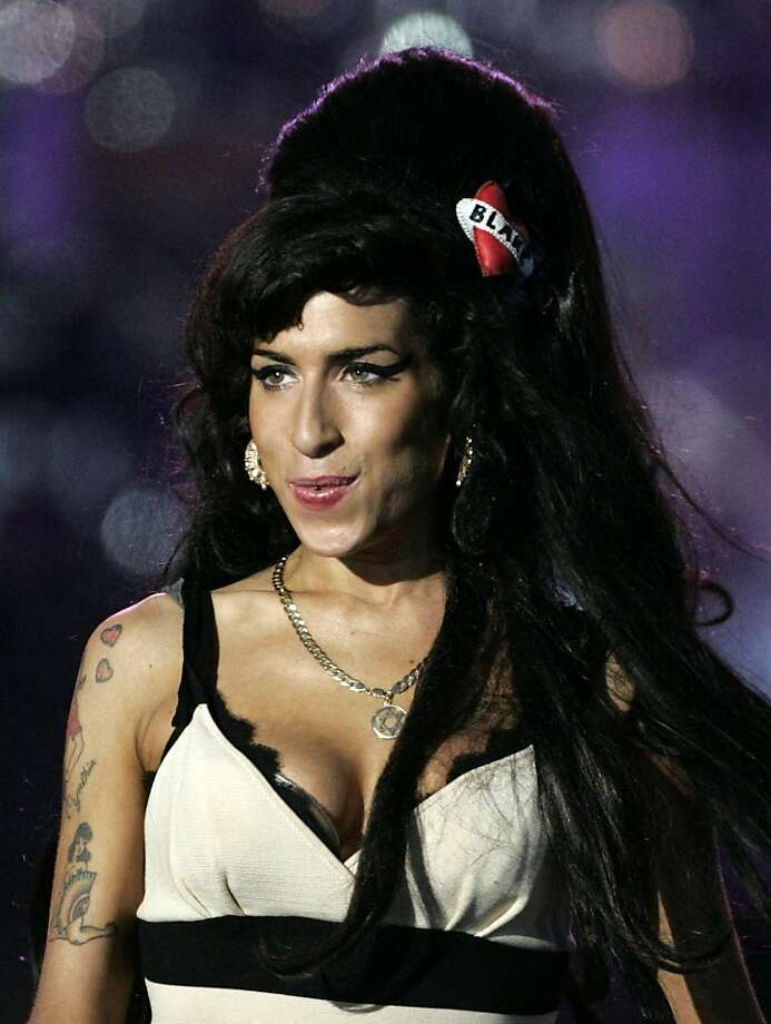 ** FILE ** In this June 27, 2008 file photo, British singer Amy Winehouse performs at the 46664 charity concert in honour of Nelson Mandela's 90th birthday in London. (AP Photo/Lefteris Pitarakis, file) Photo: Lefteris Pitarakis, AP