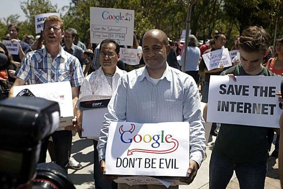 "Daniel Linver (left) of San Francisco, Samblu Agarwala (second from left) of Mountain View and James Rucker (second from right), executive director of ColorOfChange.org which is part of the Save The Internet Coalition, carry boxes to Google headquarters filled with more than 300,000 petition signatures asking Google to stand by it's ""don't be evil"" motto and to call off a deal with Verizon that would jeopardize the future of the open Internet in Mountain View, Calif. on Friday August 13, 2010.  Activists gathered at Google's Mountain View headquarters to protest Google's altered stance on net neutrality at Google headquarters. Photo: Lea Suzuki, The Chronicle"