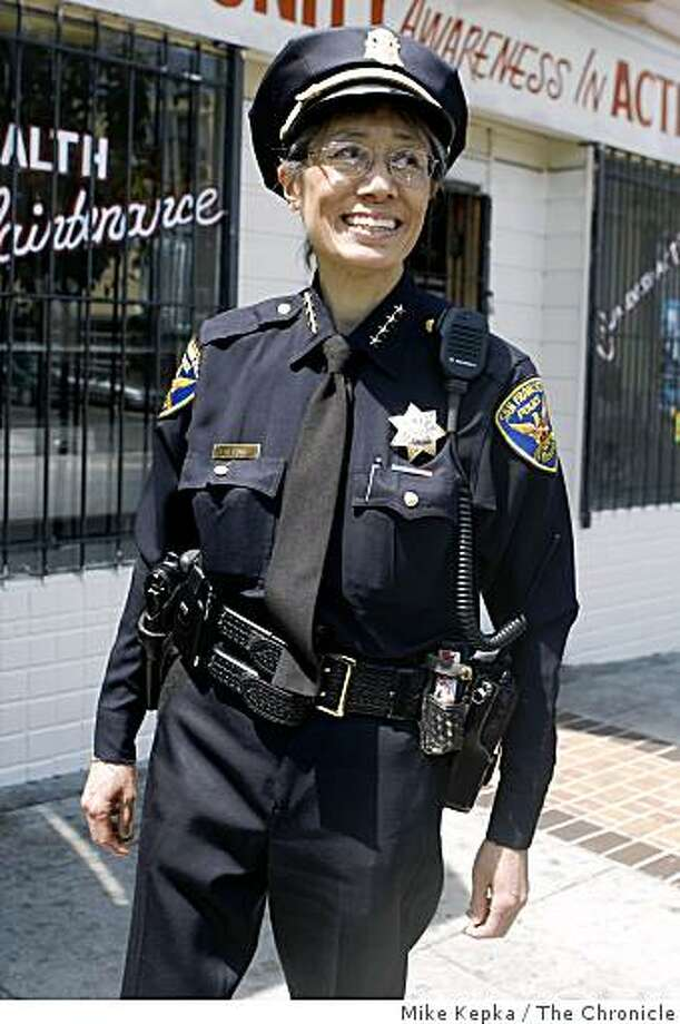 Sgt. Neville Gittens to her left, and Capt. John Loftus to her right, San Francisco Police Chief Heather Fong meets with community members on 3rd Street in the Bayview District on Thursday August 14, 2008 in San Francisco Calif. Photo: Mike Kepka, The Chronicle
