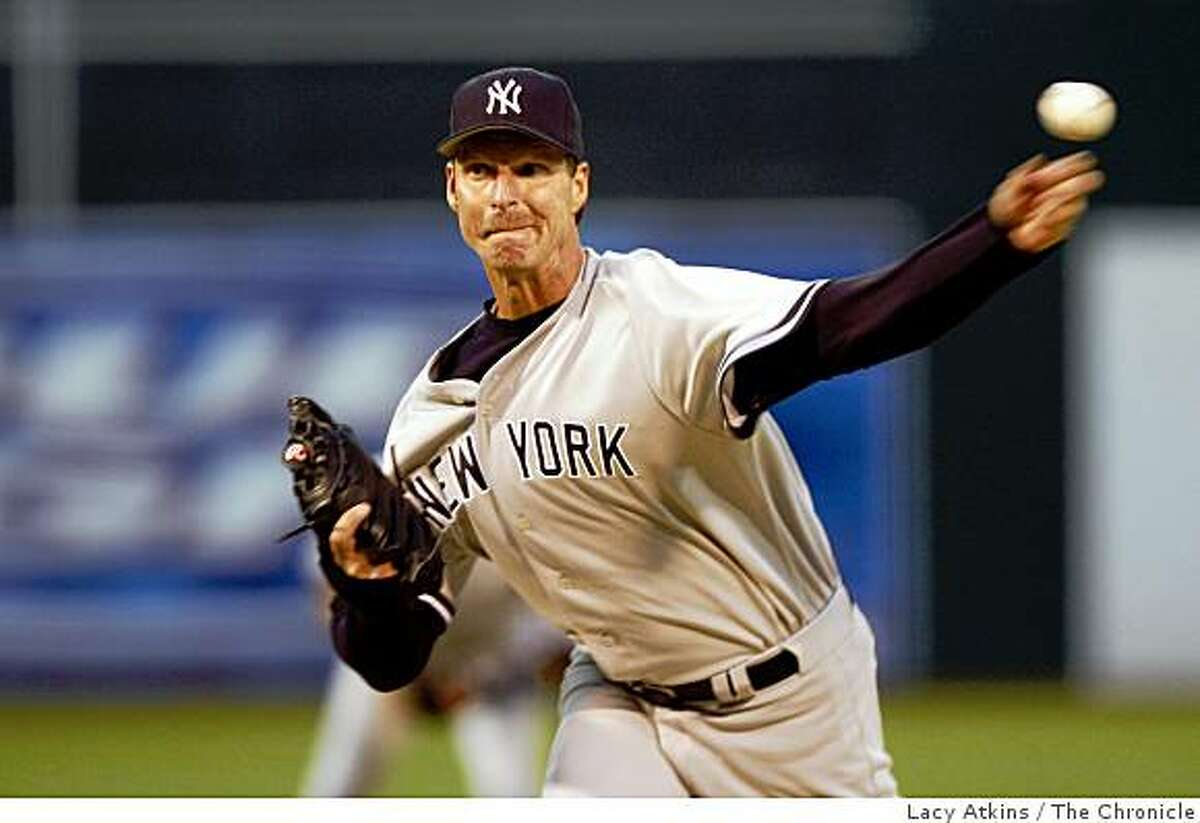 New York Yankees' Randy Johnson delivers a pitch against the Oakland A's in their home opener on April 3, 2006 at McAfee Coliseum in Oakland, Calif.