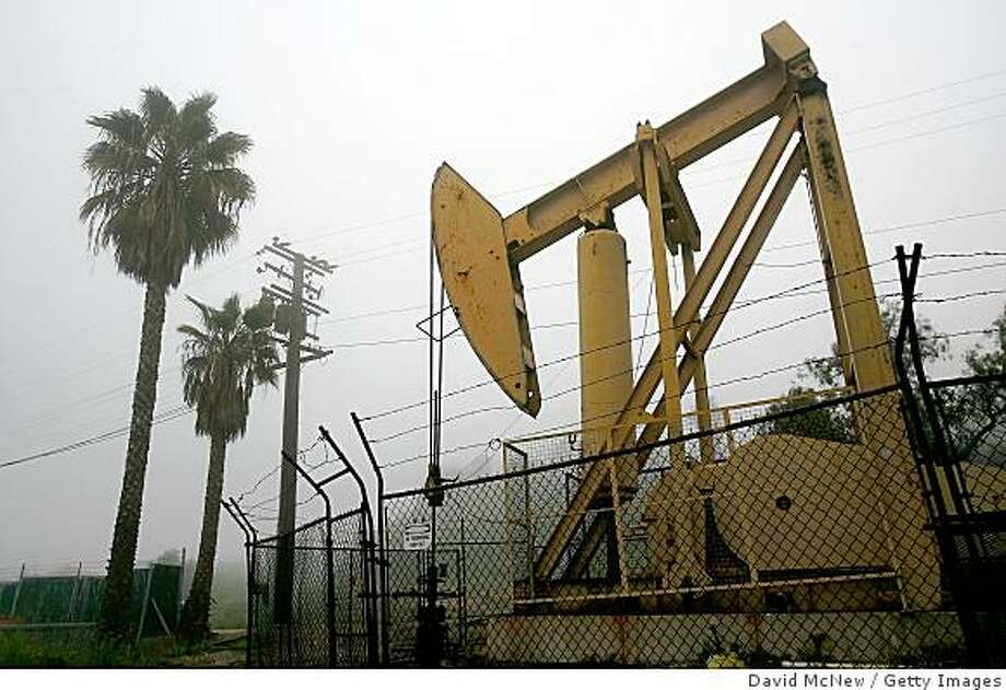 SIGNAL HILL, CA - MARCH 6:  Pumps draw petroleum from oil wells as the cost of crude oil tops $104 per barrel in its surge to new record high prices March 6, 2008 in Signal Hill, California. The cost of crude has California drivers paying more than ever. Statewide gas prices are now 58 cents a gallon higher than the same time last year.  (Photo by David McNew/Getty Images) Photo: David McNew, Getty Images