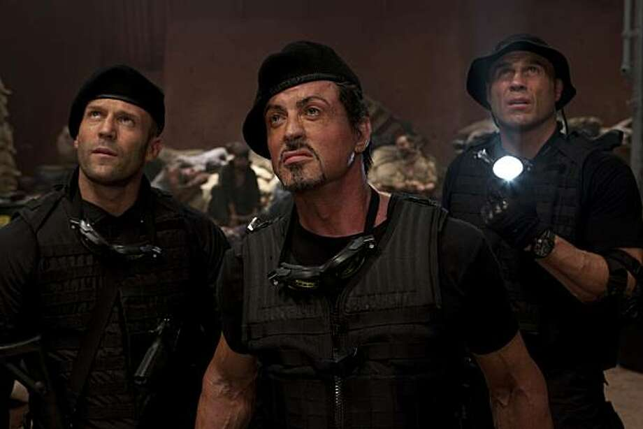"In this film publicity image released by Lionsgate Entertainment, from left, Jason Statham, Sylvester Stallone and Randy Couture are shown in a scene from ""The Expendables."" Photo: Karen Ballard, AP"