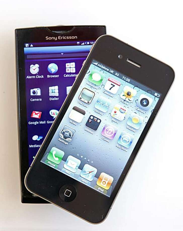 A Sony Ericsson Xperia X10 smartphone running Google Inc.'s Android operating system, left, and an Apple Inc. iPhone 4 are arranged for a photograph in London, U.K., on Wednesday, July 7, 2010. Global smartphone sales will rise 36 percent to 247 million in 2010, ISuppli Corp. said in April. Photographer: Chris Ratcliffe/Bloomberg Photo: Chris Ratcliffe, Bloomberg