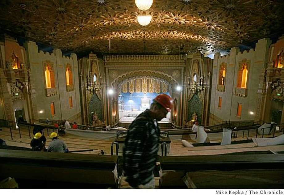 A month before scheduled completion, workers put the finishing touches on the Fox Theater on Tuesday Dec. 23 ,2008 in Oakland, Calif. Photo: Mike Kepka, The Chronicle