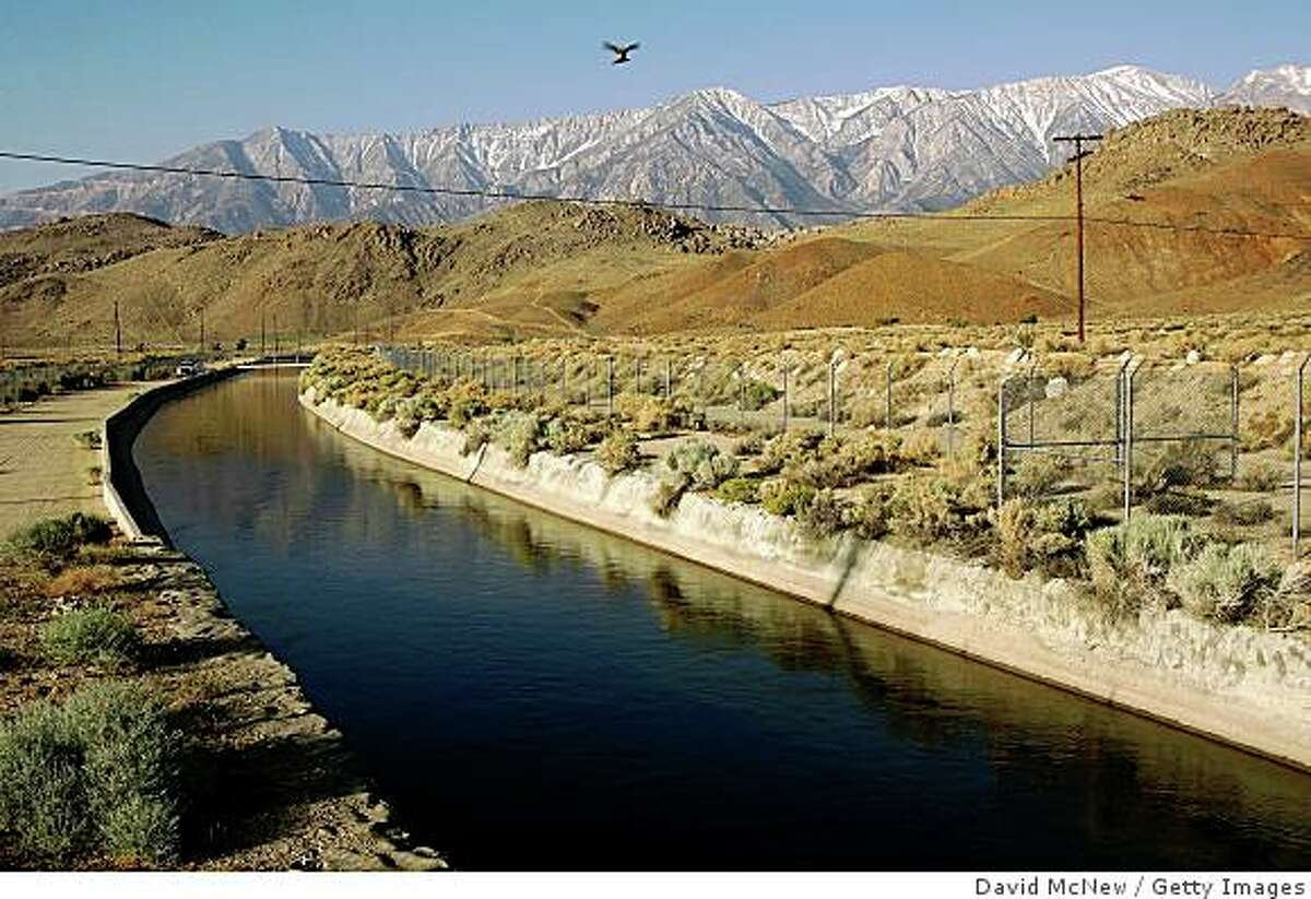 LONE PINE, CA - MAY 09: The Los Angeles Aqueduct carries water from the snowcapped Sierra Nevada Mountains, which carry less snow than normal, to major urban areas of southern California on May 9, 2008 near Lone Pine, California. Urgent calls for California residents to conserve water have grown in the wake of the final Sierras snow survey of the season indicating a snow depth and water content at only 67 percent of normal levels. The Sierra snowpack is vital to California water supplies and officials are preparing plans for mandatory water conservation. In Southern California, the Metropolitan Water District, cut deliveries to farmers by nearly a third and growers in Fresno and Kings counties have not planted about 200,000 acres of crops, a third of the land irrigated by Westlands Water District. Many farmers are now selling their government-subsidized water for profit instead of using it to plant crops. Much of the California water supply comes from the Colorado River where a continuing eight-year drought has lowered water storage to roughly half of capacity. Dry conditions across the West have already doubled the wildfires this year causing fire officials to brace for a possible repeat of the devastating 2007 southern California wildfire season. (Photo by David McNew/Getty Images)