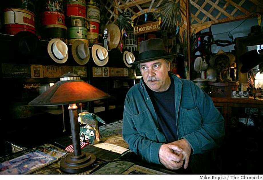 "Paul's Hat WorksA recent Wednesday 1:23 p.m.:Wearing a 60-year-old beaver felt hat, perfectly worn and faded from decades of sweat and love, Michael Harris, 61, walks past a collection of antique hatboxes and tools that took him nearly a lifetime to collect. Harris has worked at Paul's Hat Works for 38 of the store's 90 years, since the days when the store was crowded with customers. This was a time when hats went everywhere with you -- your security blanket, your shelter, a part of you. Lately it seems only dear friends and unsatisfied bargain hunters make their way into Harris' shop. ""Now I know I'm just a grain of sand on a vast beach,"" he says, knowing that he's not likely to write a check for next month's rent.To hear audio and more photos, go to sfgate.com/cityexposedE-mail Mike Kepka at mkepka@sfchronicle.com Photo: Mike Kepka, The Chronicle"