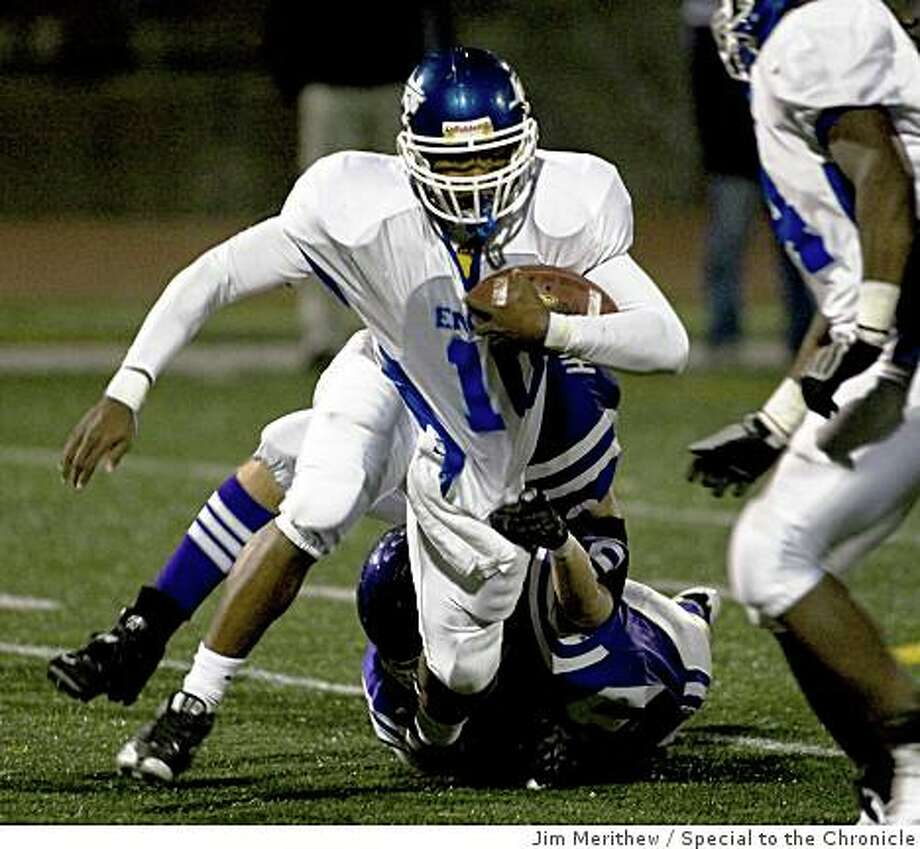 Encinal #10 Jonathon Brown drags himself free from a Piedmont defender for a short gain on the play. Alameda Encinal High School in Friday night football action against Piedmont High School at Piedmont October 10, 2008. Photo: Jim Merithew, Special To The Chronicle