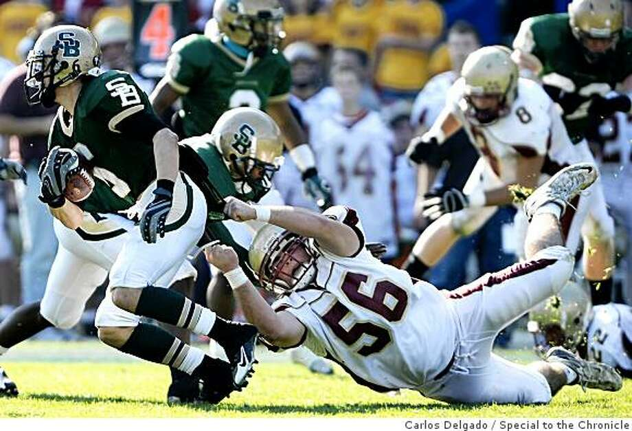 Cardinal Newman's Tyler Bowman, right, tries to tackle St. Bonaventure High School's Nolan Rodarte in the third quarter of Cardinal Newman's 28-6 loss to St. Bonaventure during the 2008 CIF Division III State Football Championship Bowl Game at the Home Depot Center in Carson, Calif., on Saturday, Dec. 20, 2008. Photo: Carlos Delgado, Special To The Chronicle