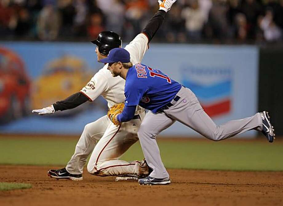Pat Burrell slides in safe on his ninth inning double to set up the possible winning run for the Giants. The San Francisco Giants played the Chicago Cubs at AT&T Park in San Francisco, Calif., on Monday, August 9, 2010. Photo: Carlos Avila Gonzalez, The Chronicle