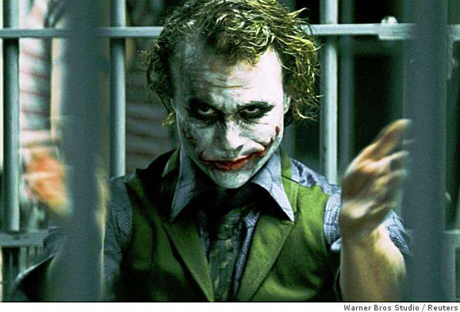"""Late actor Heath Ledger is shown in a scene playing his role as The Joker in """"The Dark Knight"""" in this undated publicity photo released to Reuters July 16, 2008. Hollywood studios are nearing the end of their summer of superheroes with domestic box office receipts expected to roughly match last year's record $4 billion sum despite lower movie attendance, August 20, 2008.    REUTERS/Warner Bros Studio/Handout      (UNITED STATES).  NO SALES. NO ARCHIVES. FOR EDITORIAL USE ONLY. NOT FOR SALE FOR MARKETING OR ADVERTISING CAMPAIGNS. Photo: Warner Bros Studio, Reuters"""
