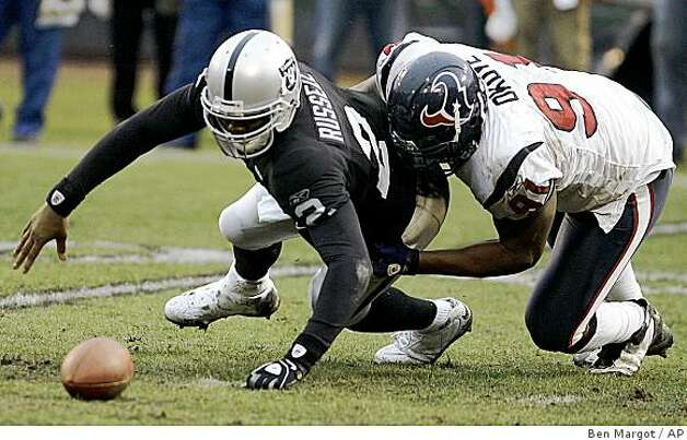 Oakland Raiders quarterback JaMarcus Russell (2) tries to recover the ball after being sacked by Houston Texans tackle Amobi Okoye during the fourth quarter of a game Sunday, Dec. 21, 2008, in Oakland. Photo: Ben Margot, AP