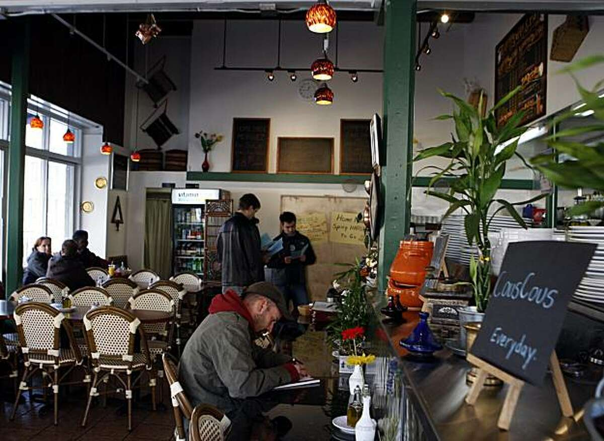 Diners wait to place their orders at Cafe Zitouna restaurant in San Francisco, Calif., on Saturday, Dec. 6, 2008.