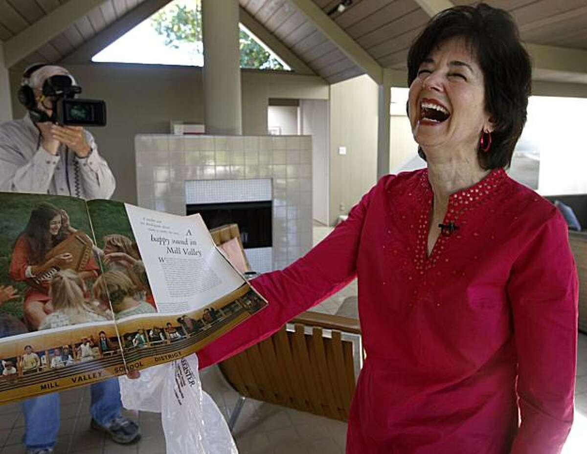 Former third grade teacher Rita Abrams laughs while viewing a photo of herself that appeared in the Sept. 25, 1970 edition of Life magazine singing with several of her students. Abrams reunited with several of her former students in Mill Valley, Calif., on Thursday, July 15, 2010, who together recorded a surprise hit song about their hometown of Mill Valley 40 years ago, and was featured in the magazine as a result.