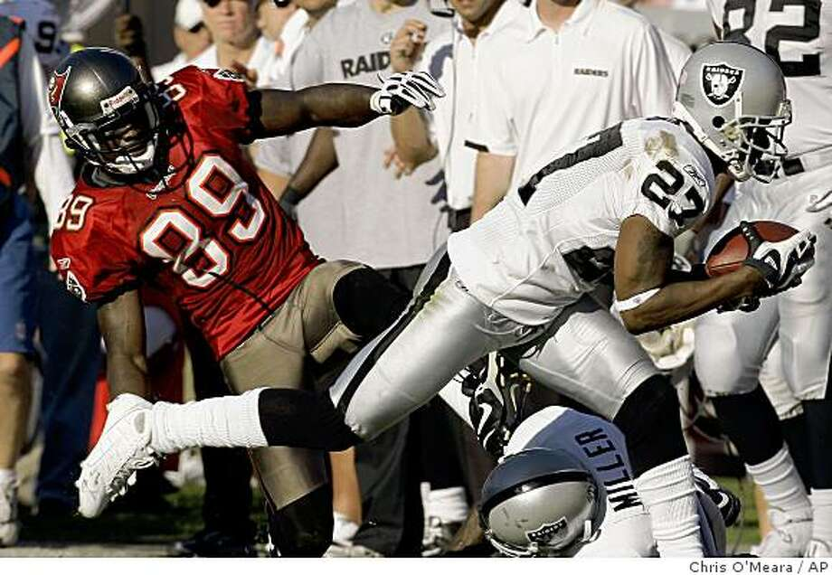 Oakland Raiders' Rashad Baker (27) intercepts a second-half pass intended for Tampa Bay Buccaneers' Antonio Bryant (89) during a game Sunday, Dec. 28, 2008, in Tampa, Fla. Photo: Chris O'Meara, AP