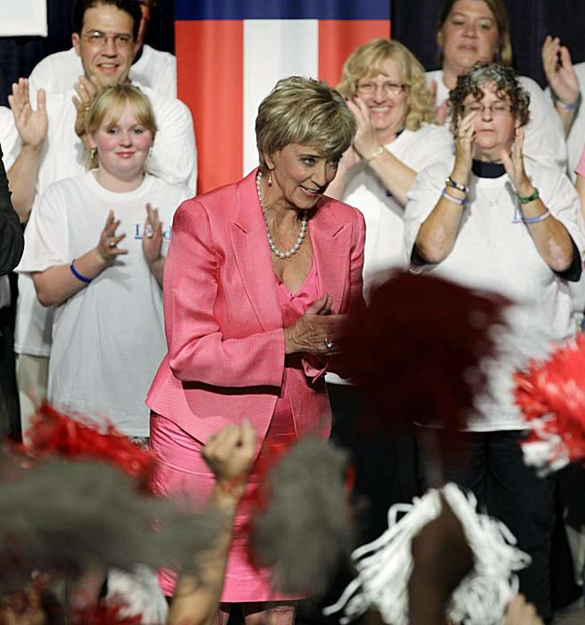 Republican candidate for U.S. Senate Linda McMahon, a former wrestling executive, bows as supporters cheer during her campaign party after winning the Republican primary in Cromwell, Conn., Tuesday, Aug. 10, 2010.
