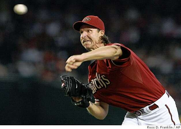 ** FILE ** In this Sept. 28, 2008 file photo, Arizona Diamondbacks' Randy Johnson throws against the Colorado Rockies in the first inning of a baseball game  in Phoenix.  Johnson and the San Francisco Giants agreed to a one-year contract Friday, Dec. 26, 2008,  meaning the 45-year-old pitcher will go for his 300th win with a new team. (AP Photo/Ross D. Franklin) Photo: Ross D. Franklin, AP