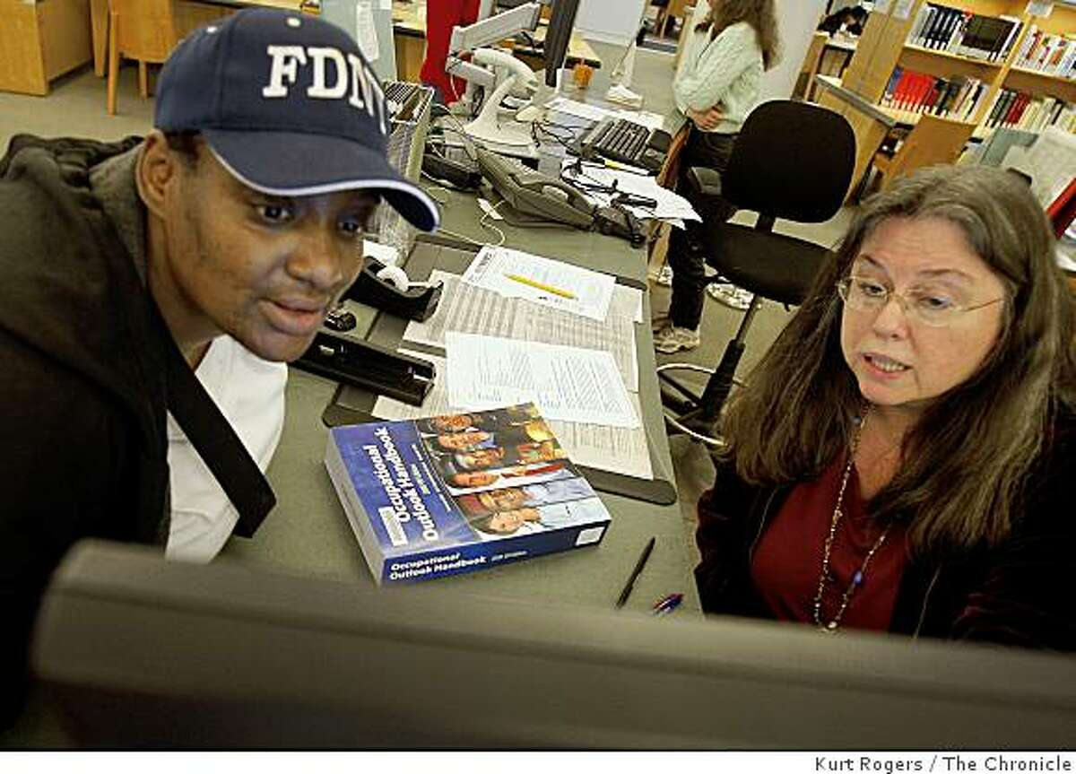 Susan Cohen (RIGHT) who works with people who are looking for jobs in the Business, Science and Technology Center in the City�s main Library. Helps Melvina York who is looking for a job as a Child Advocate.. on Wednesday Dec 24, 2008 in San Francisco , Calif