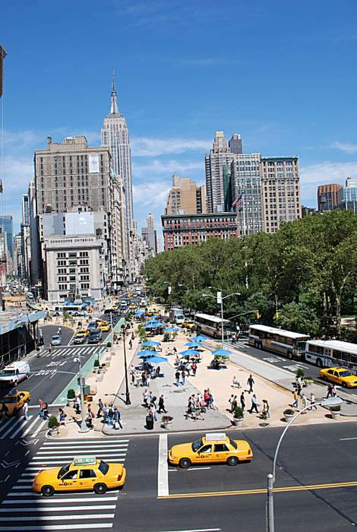 Nearly one acre of traffic lanes of Fifth Avenue and Broadway across from Madison Square Park in New York have been converted into public spaces -- an example of how Manhattanization these days has good connotations as well as bed.