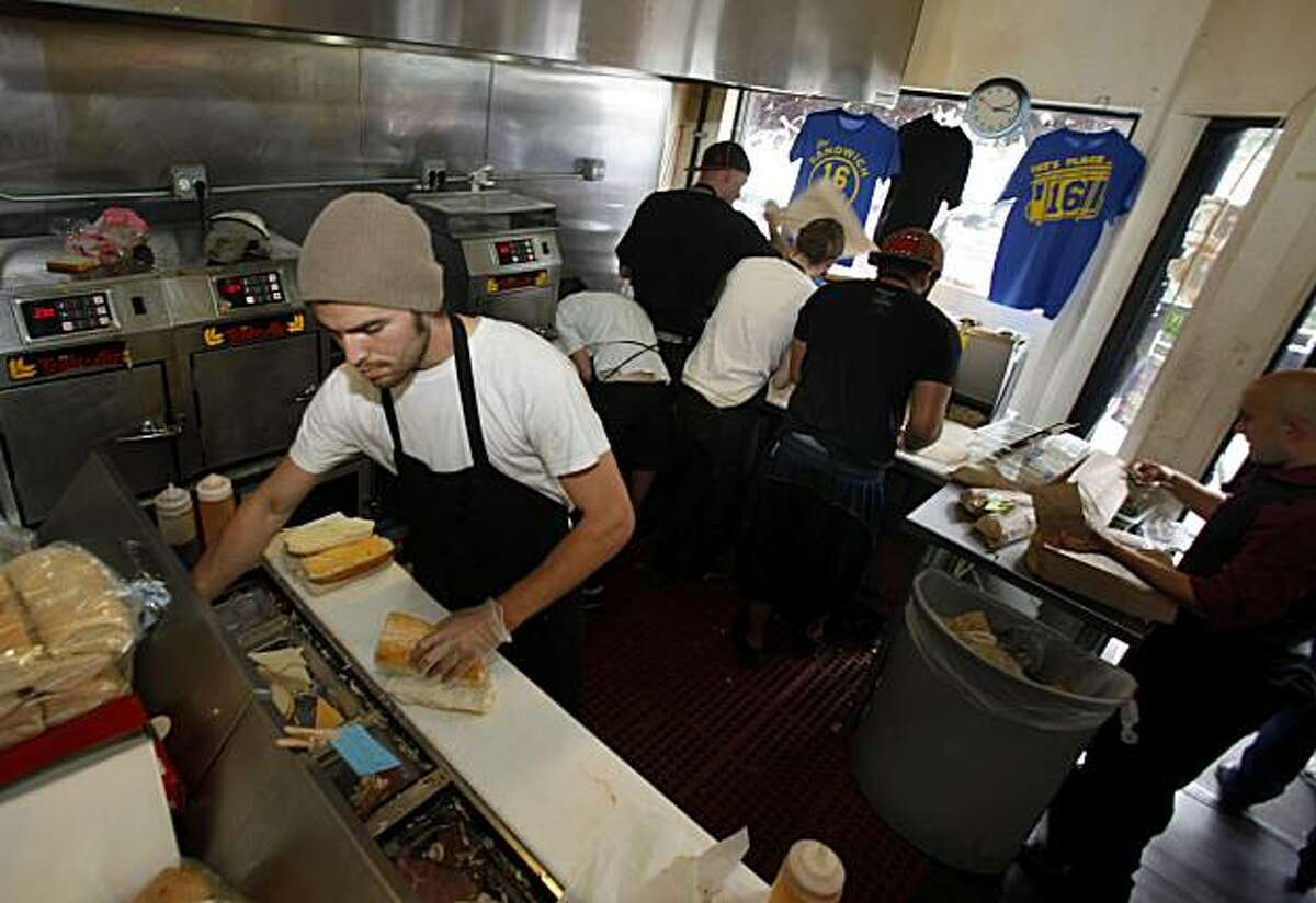 Jesse Castellanos has been making great sandwiches at Ike's for over two years in the crowded kitchen. The popular Ike's sandwich store on 16th Street in San Francisco, Calif. is in danger of being shut down because of some recent unresolved legal issues Thursday August 5, 2010.