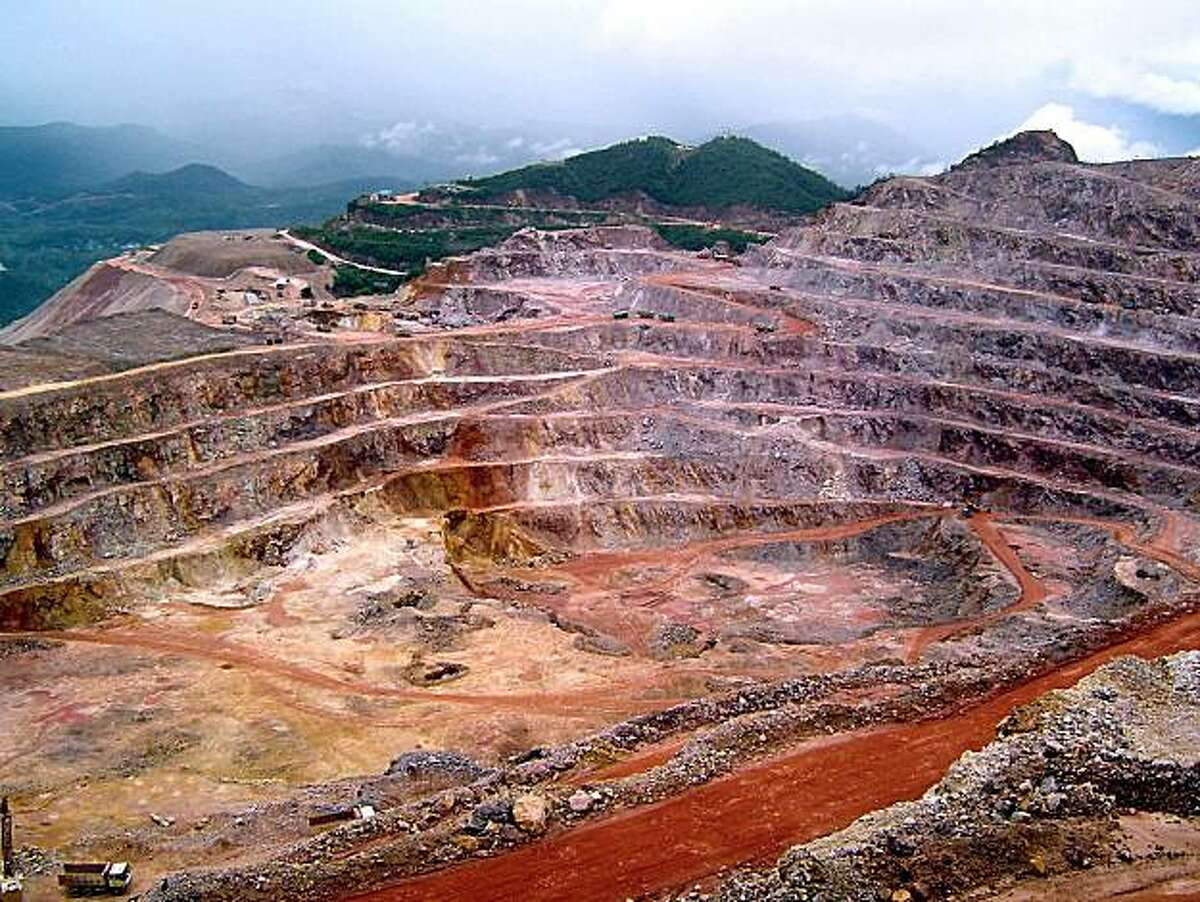 In this photo taken on August 20, 2005 and made available July 14, 2010, the Zijinshan copper mine owned by Zijin Mining Group is seen in Shanghang county in Longyan city in south China's Fujian province. Zijin is known in China as an environmental villain after a July 3, 2010, leak of toxic waste from a copper mine into a major river killed fish and fouled drinking water for 60,000 people.