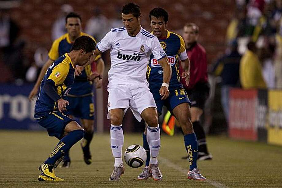 Cristiano Ronaldo (7) of Spain's Real Madrid fights for the ball while being defended players of Mexico's Club America during a match at Candlestick Park in San Francisco, Calif. on Wednesday, Aug., 4, 2010. Photo: Stephen Lam, Special To The Chronicle