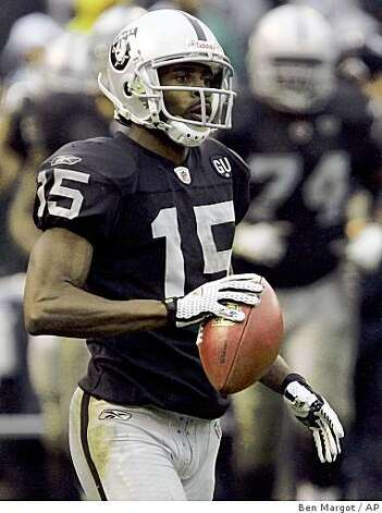 Oakland Raiders wide receiver Johnnie Lee Higgins during the fourth quarter of a game against the Houston Texans, Sunday, Dec. 21, 2008, in Oakland, Calif.  Higgins returned a punt 80 yards for a touchdown against the Texans. Photo: Ben Margot, AP