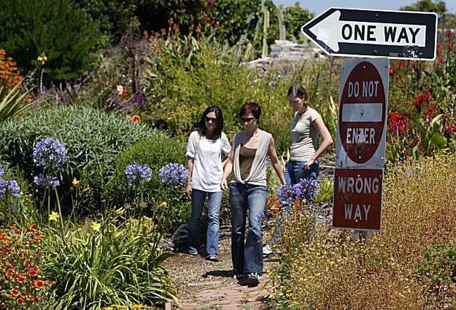 Arum Ahn (left), Annie Shaw (center) and Emily Gogol visit the Pennsylvania Avenue Garden in San Francisco, Calif., on Friday, July 16, 2010. The three Potrero Hill neighbors organized a community effort to start up and maintain the garden which is located next to the Mariposa Street off-ramp from Interstate 280. Photo: Paul Chinn, The Chronicle