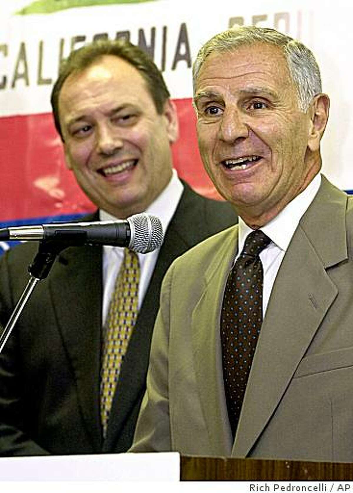 Republican gubernatorial candidate, Secretary of State Bill Jones, left, looks on as former California Gov. George Deukmejian anwers questions during a news conference Wednesday, June 20, 2001, in Sacramento, Calif. It was announced Wednesday that Jones has tapped the former two-term governor to chair his campaign. (AP Photo/Rich Pedroncelli)