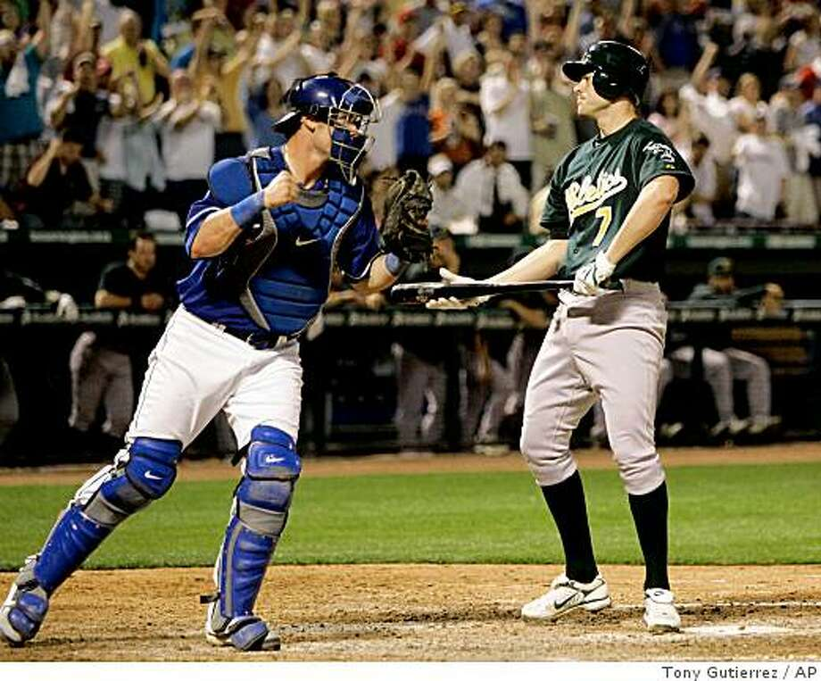 Texas Rangers catcher Jarrod Saltalamacchia, left, pumps his fist as he celebrates following Oakland Athletics' Bobby Crosby's (7) strike out against Rangers closer C.J. Wilson to end the game in a Major League Baseball game, Friday, May 9, 2008, in Arlington, Texas. The Rangers won 4-0. (AP Photo/Tony Gutierrez) Photo: Tony Gutierrez, AP